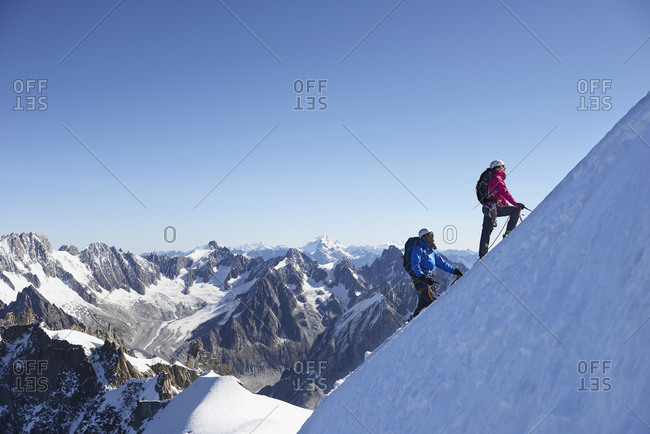 Mountain climber on snowy slope, Chamonix, Rhone-Alps, France