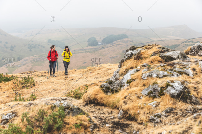 Hikers using walking poles, Chrome Hill, Peak District, Derbyshire