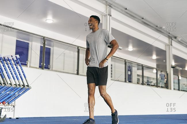 Runner training on indoor running track