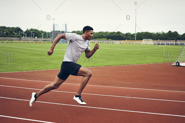 Runner training on running track