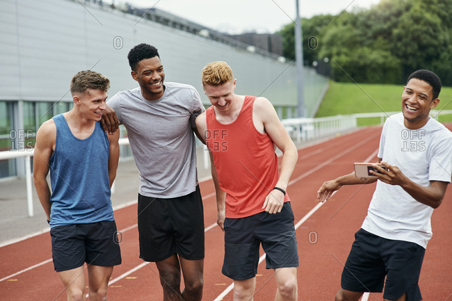 Friends talking on running track