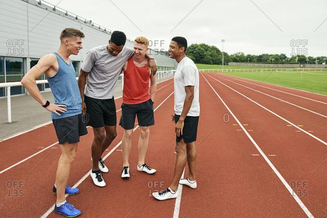 Friends talking on running track