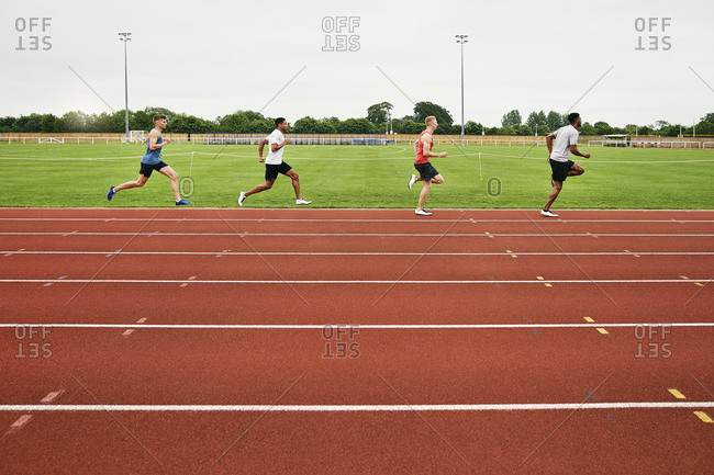Runners training on running track