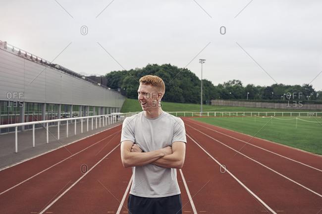 Portrait of athlete on running track