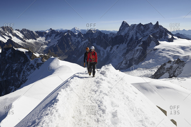 Mountain climbers on snowy trail, Chamonix, Rhone-Alps, France