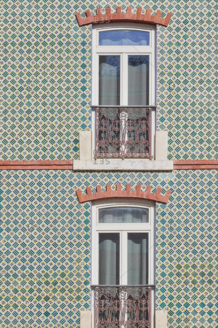 Window surrounded by decorative tile, Lisbon, Portugal
