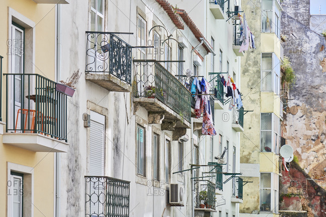 Laundry hanging from balconies on apartments in the Arroios neighborhood