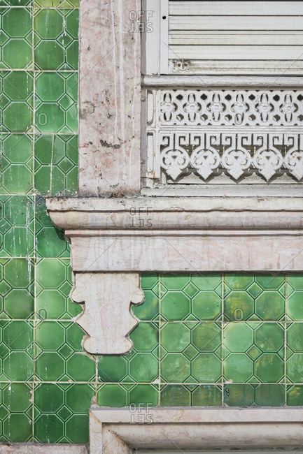Detail of a window surrounded by green decorative tile, Lisbon, Portugal