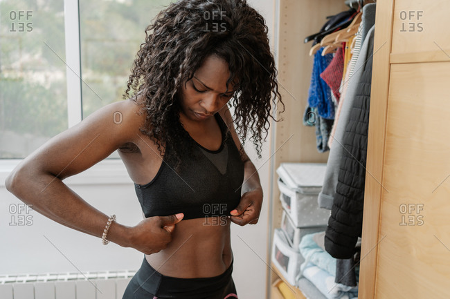 Black woman getting ready for a workout