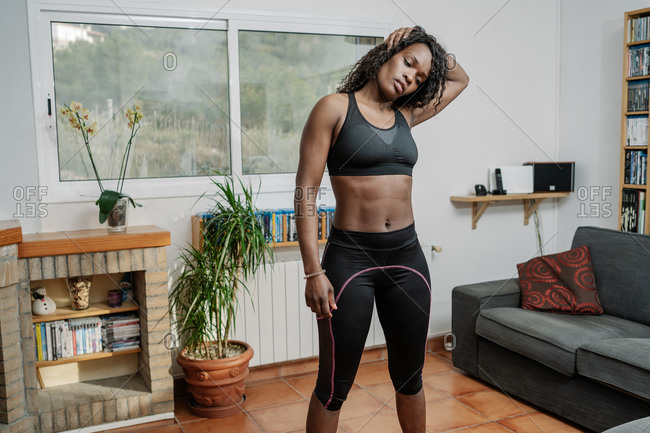 Young Black Woman Stretches Home During Coronavirus Confinement