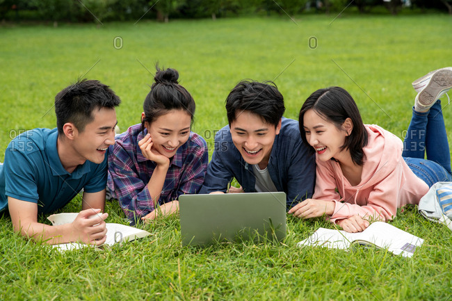 Happy learning of college students on grass