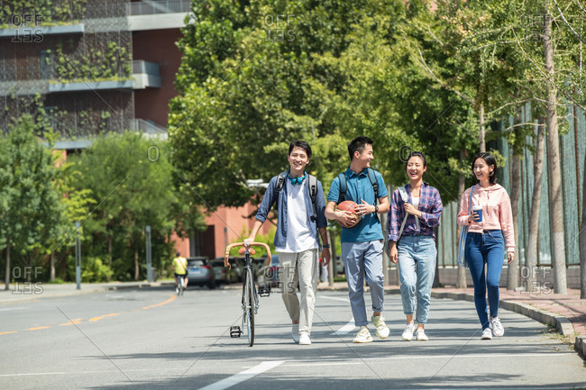 Happiness of college students walking in the campus