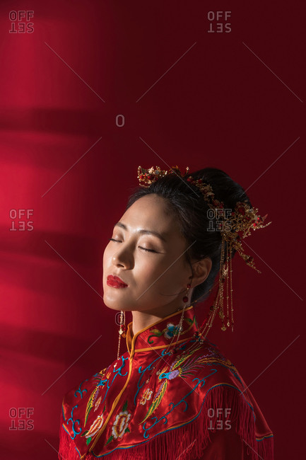 Chinese bride with closed eyes to relax