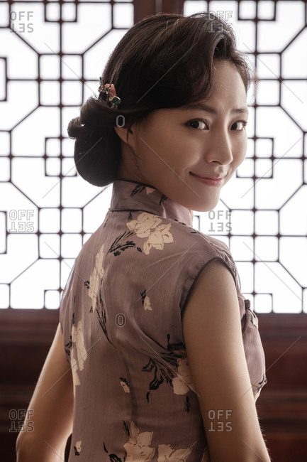 Oriental women wear qipao - Offset
