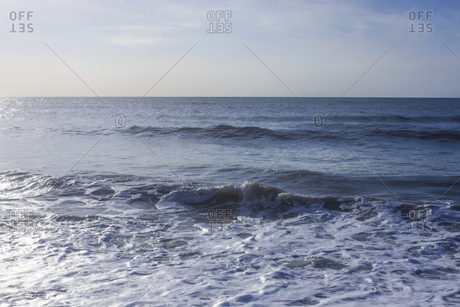 Small waves breaking in the Pelican Beach area of Naples, Florida.