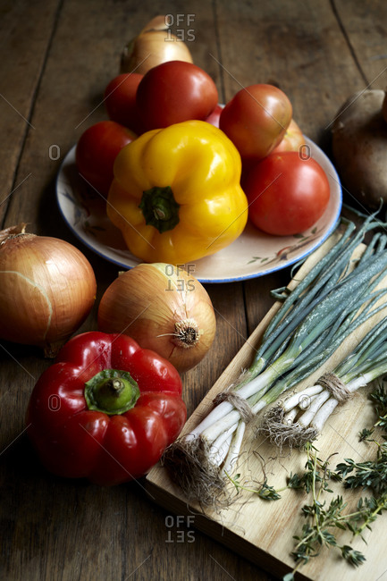 Fresh produce laid out on a wooden kitchen table,
