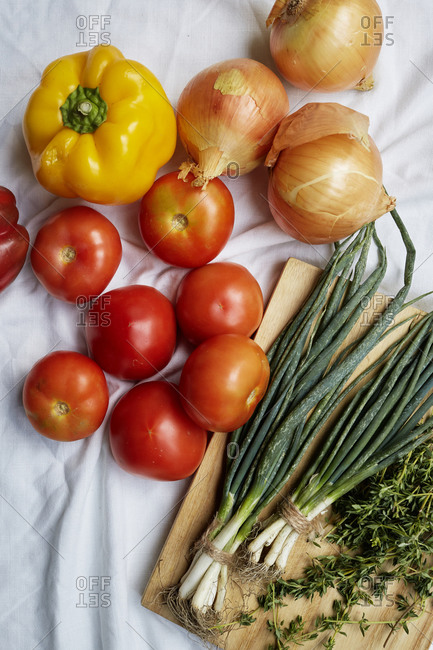 Fresh produce laid out on a white linen cloth,