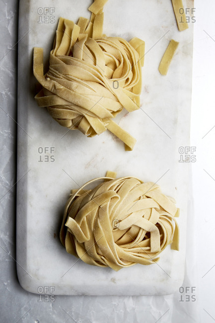 Bunches of fresh, handmade raw pasta on a plate,
