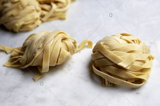 Fresh homemade pasta on a kitchen countertop shot from the side,