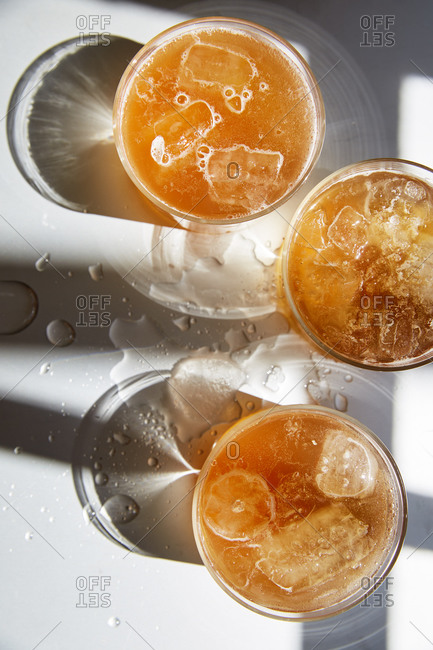 Three glasses of kombucha served and shot from above,