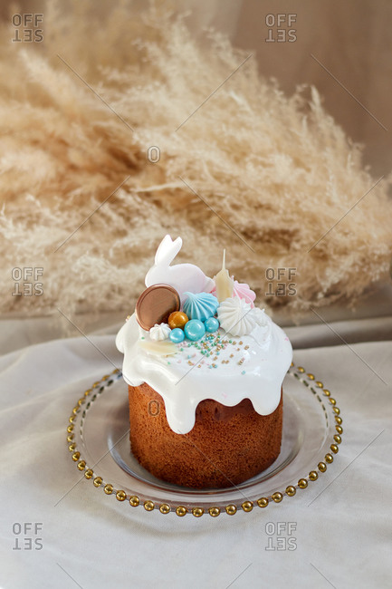 Cake for the Easter holiday in April with rabbit and desserts with white icing