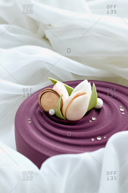 dessert a beautiful wedding mousse cake with a matte lilac top and a decor of chocolate flowers