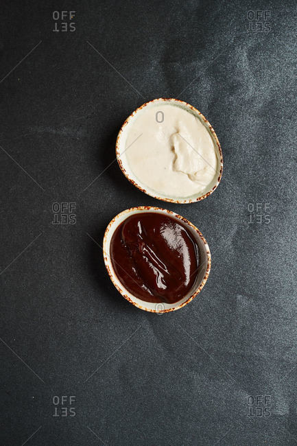 on a dark background sauces tomato barbecue and mayonnaise