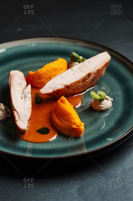 molecular pumpkin puree, tomato dishes, chicken breast with a puree of celery, sunflower seeds, greens