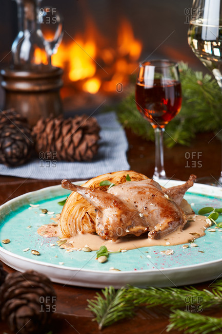 dinner white wine, grilled quail with cabbage, sauce and pumpkin seeds