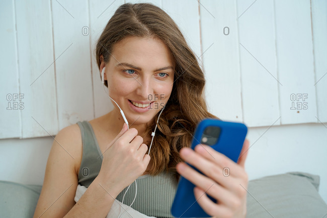 woman using smartphone for video call for work, friends, family, study during quarantine