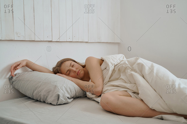 woman sleeps at home in bed during quarantine, morning Wake-up hours, laziness and relaxation, bedtime