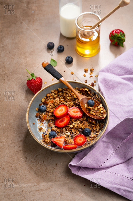 Close up of breakfast granola bowl with berry