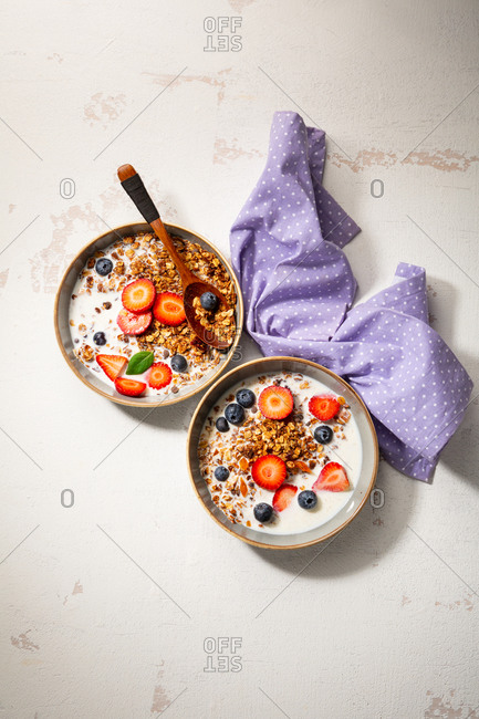 Overhead view of healthy breakfast bowls and cloth