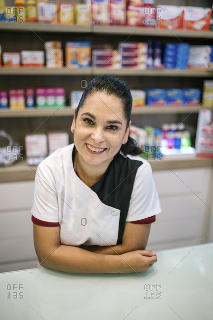 Portrait of a caucasian woman in dressing gown at a pharmacy counter