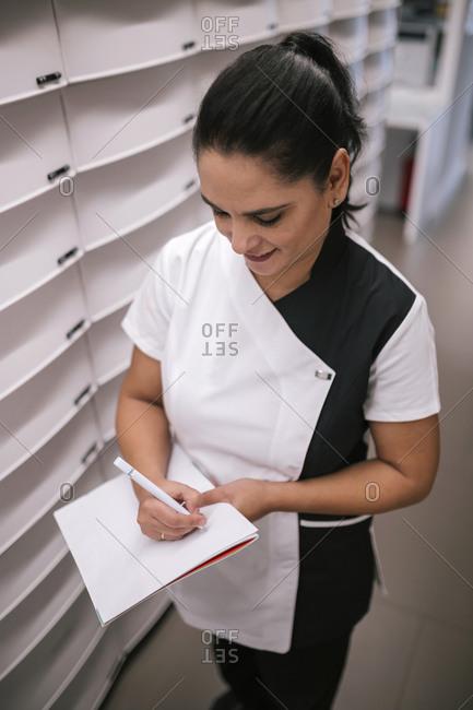 Pharmaceutical woman placing order