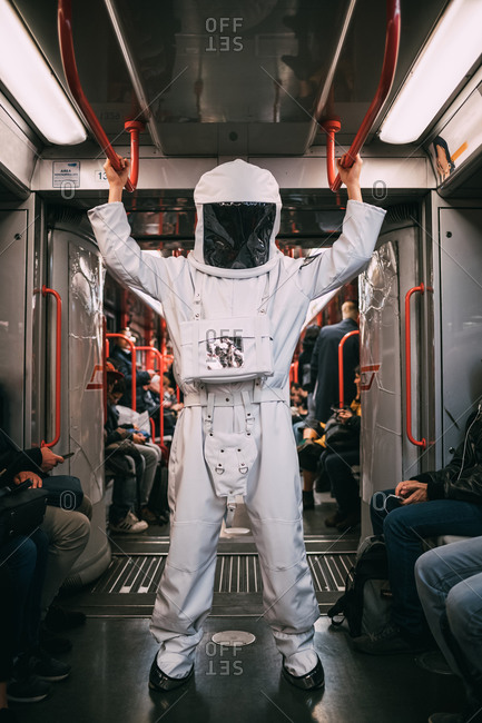 Astronaut travelling in train