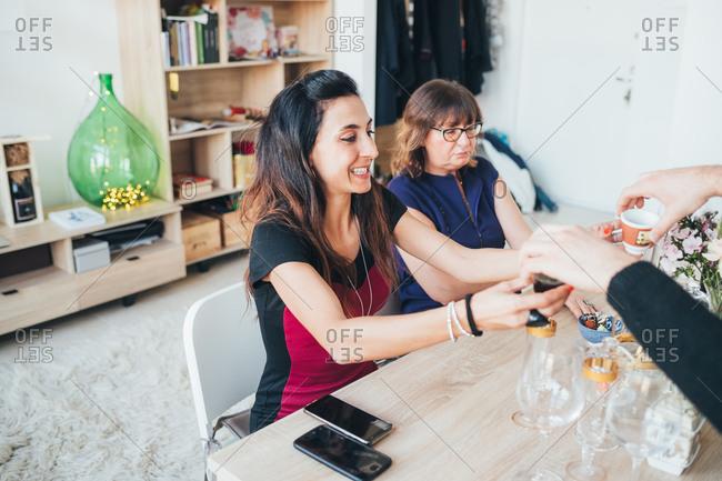 Businesswomen having coffee in loft office