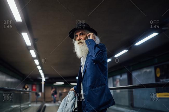 Senior businessman using smartphone inside terminal