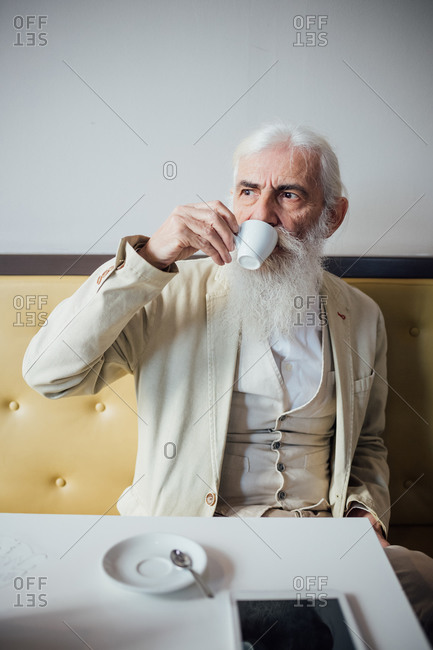 Senior businessman drinking coffee in cafe