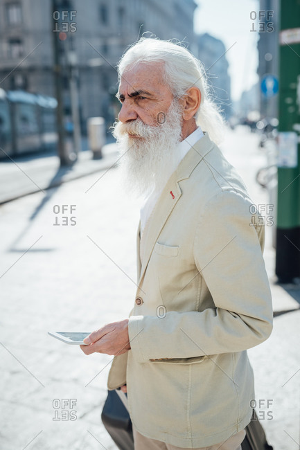 Senior businessman exploring city, Milano, Lombardia, Italy