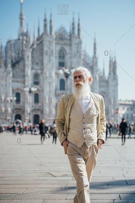 Senior businessman exploring city, Milan Cathedral in background, Milano, Lombardia, Italy