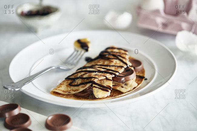 Banana chocolate pancake with chocolate sauce