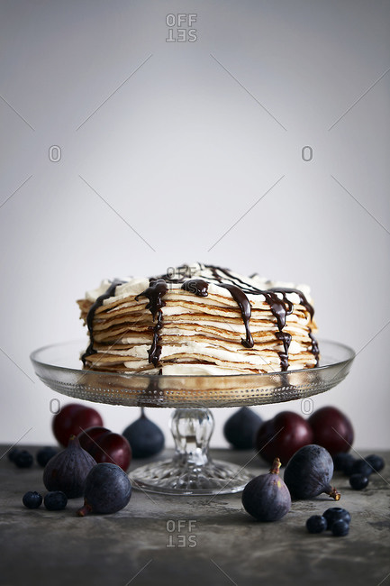Pancake stack with chocolate sauce, whole figs