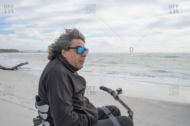 Man on wheels enjoying seaside