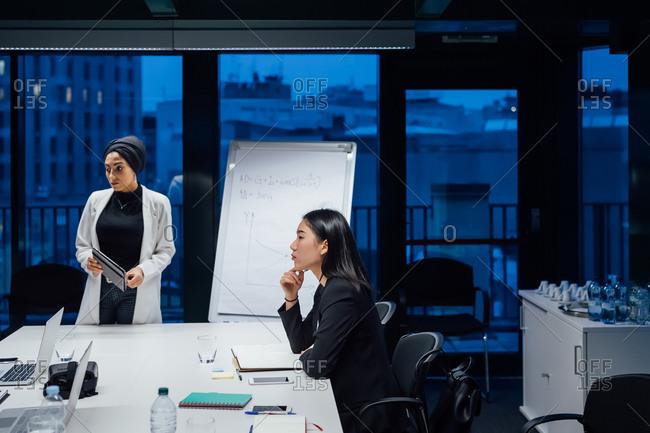 Businesswomen listening during office presentation