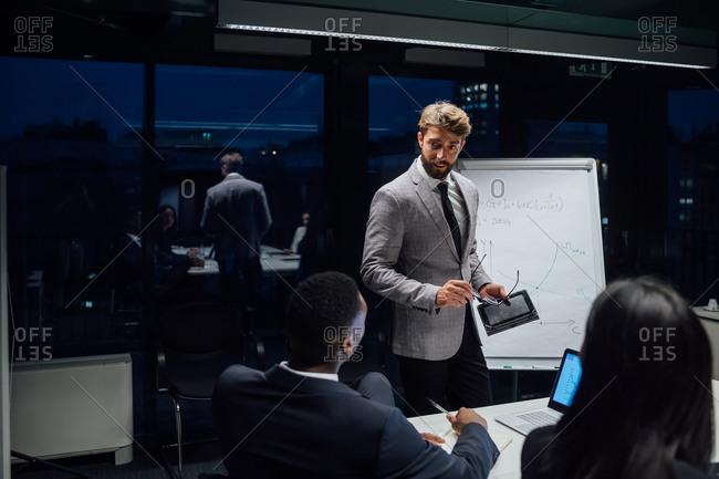 Businessman using digital tablet during office presentation