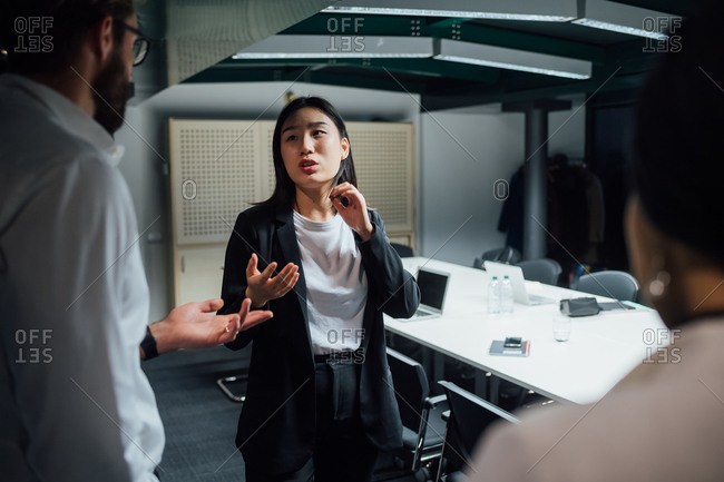 Businesswoman explaining to team in office