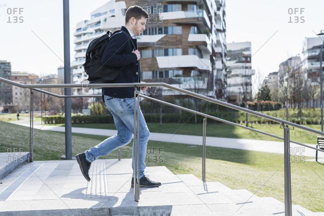 Man running down stairway, Milan, Lombardia, Italy