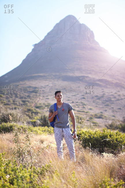Young male hiker hiking near mountain in Table Mountain National Park, Cape Town, Western Cape, South Africa