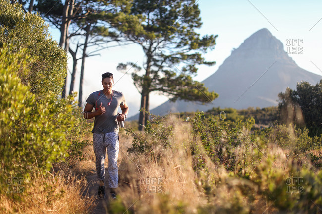 Young male runner running in rural landscape, Cape Town, Western Cape, South Africa